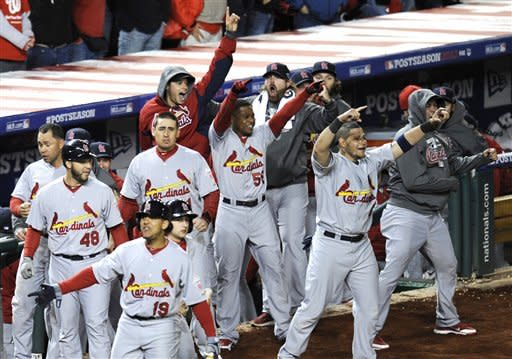 Members of the St. Louis Cardinals react after Pete Kozma batted in David Freese and Daniel Descalso on a single in the ninth inning of Game 5 of the National League division baseball series against the Washington Nationals early Saturday, Oct 13, 2012, in Washington. (AP Photo/Nick Wass)