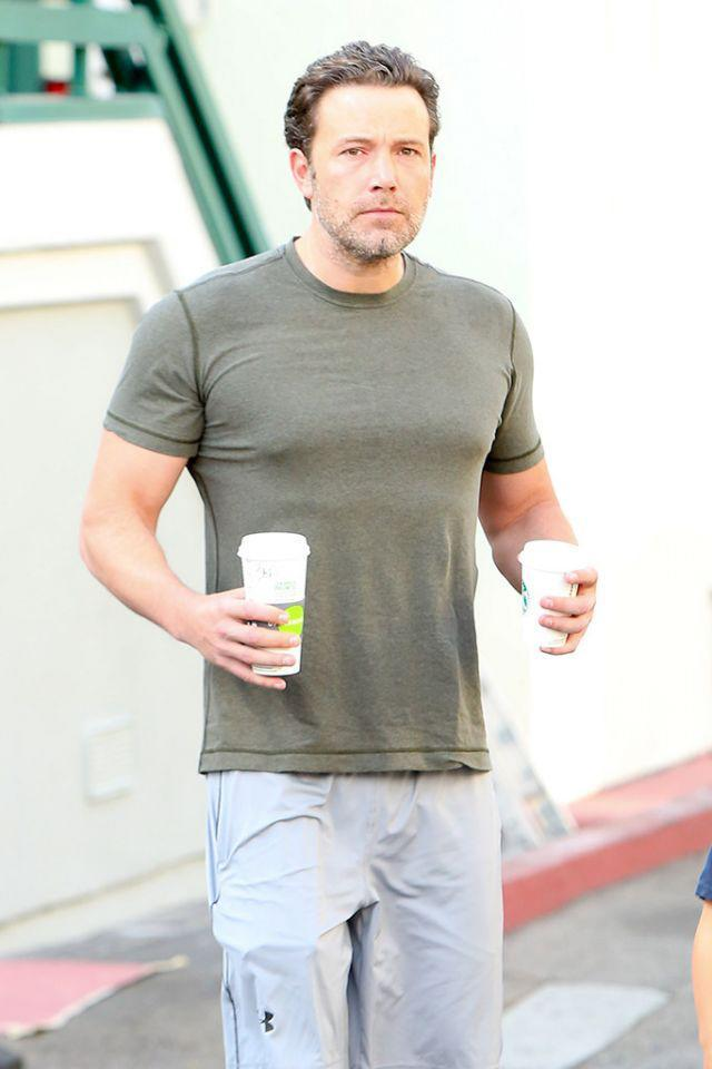 <p>The actor and director wasn't alone when he hit up a local coffee shop. Think the smaller cup was hot chocolate for his son, Samuel? (Photo: AKM-GSI) </p>