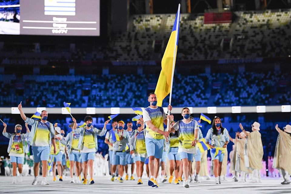 Flag bearers Olena Kostevych and Bogdan Nikishin of Team Ukraine during the opening ceremony.