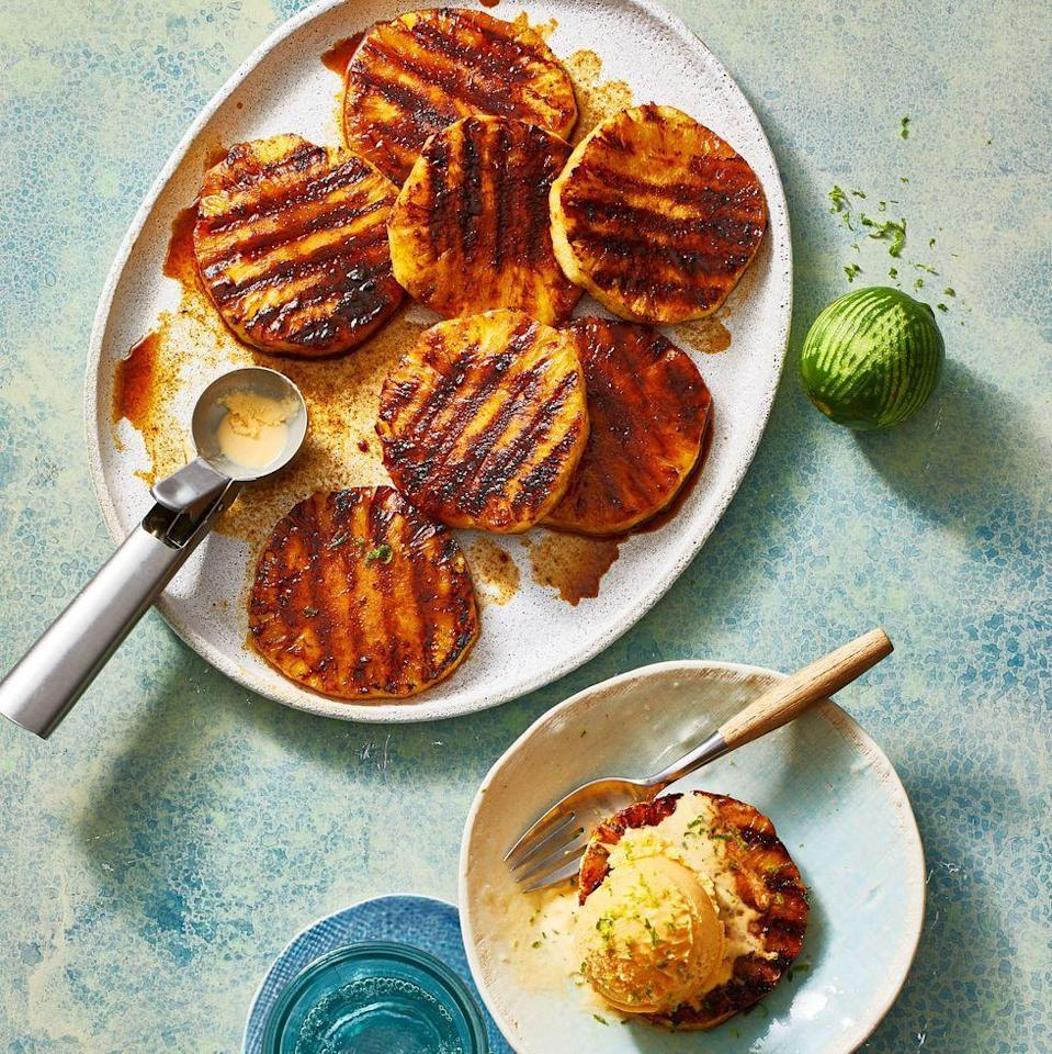 """<p>Don't heat up the kitchen and take your dessert to the grill! Serve with vanilla ice cream to complete the sweet.</p><p><em><a href=""""https://www.goodhousekeeping.com/food-recipes/dessert/a31915070/grilled-pineapple-recipe/"""" rel=""""nofollow noopener"""" target=""""_blank"""" data-ylk=""""slk:Get the recipe for Grilled Pineapple »"""" class=""""link rapid-noclick-resp"""">Get the recipe for Grilled Pineapple »</a></em></p>"""