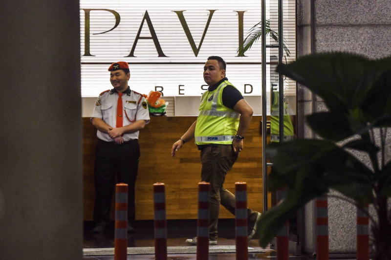 Police are seen in the lobby of luxury apartment building Pavilion Residences on Jalan Raja Chulan in Kuala Lumpur May 17, 2018. — Bernama pic