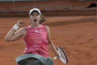 Poland's Iga Swiatek celebrates after defeating Ukraine's Marta Kostyuk during in fourth round match on day 9, of the French Open tennis tournament at Roland Garros in Paris, France, Monday, June 7, 2021. (AP Photo/Christophe Ena)