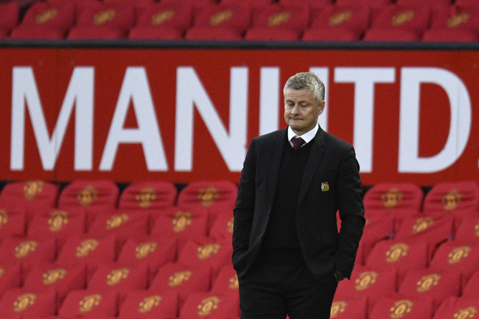 Manchester United's manager Ole Gunnar Solskjaer reacts after Tottenham scored their sixth goal during the English Premier League soccer match between Manchester United and Tottenham Hotspur at Old Trafford in Manchester, England, Sunday, Oct. 4, 2020. (Oli Scarff/Pool via AP)