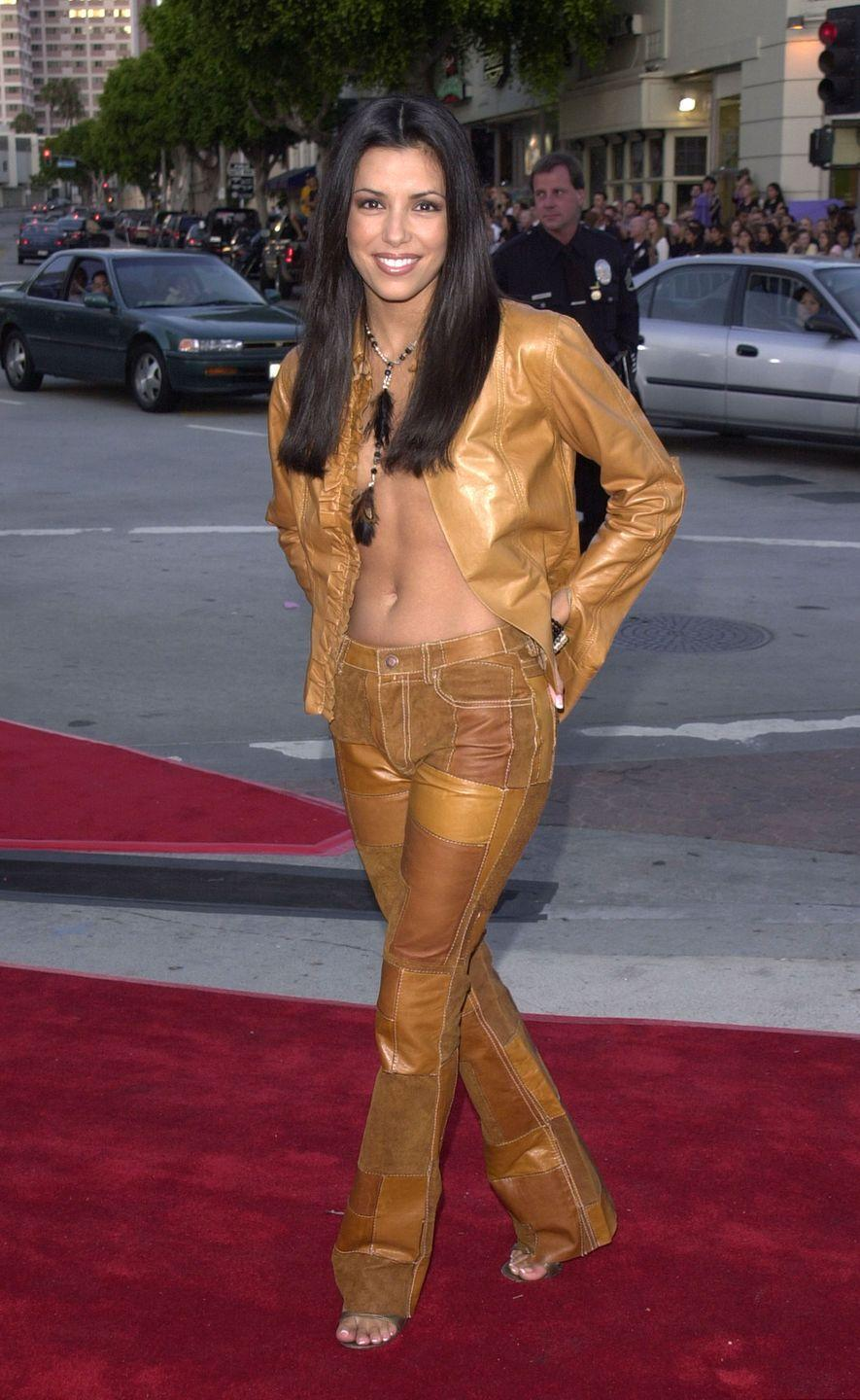 <p>Eva showed up to the <em>Lara Croft: Tomb Raider</em> premiere in patchwork leather pants in many shades of brown. The pants and the matching jacket made such a statement, no shirt was necessary.</p>