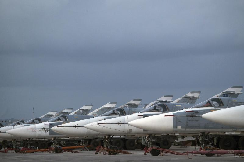 <p> FILE- In this file photo dated Friday, March 4, 2016, Russian warplanes are parked at Hemeimeem air base in Syria. A Russian reconnaissance aircraft was brought down over the Mediterranean Sea as it was returning to its home base inside Syria, killing all 15 people on board, the Russian defense ministry said Tuesday Sept. 18, 2018. (AP Photo/Pavel Golovkin, FILE) </p>