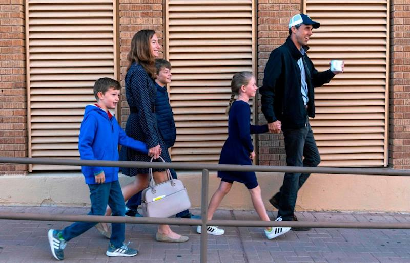 Beto O'Rourke walks with his wife, Amy Hoover Sanders, and his three children, Ulysses, Henry and Molly in El Paso on 6 November 2018.