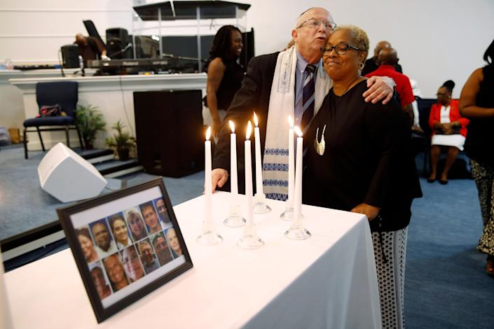 Rabbi Israel Zoberman, left, embraces churchgoer Pamela Johnson after a vigil at Piney Grove Baptist Church, June 2, 2019, in response to a mass shooting at a municipal building in Virginia Beach, Va. (Photo: Patrick Semansky/AP)
