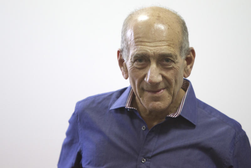 FILE - In this Sept. 24, 2012 file photo, Former Israeli Prime Minister Ehud Olmert attends the sentence hearing in a corruption case, at Jerusalem's District Court. Olmert is considering a political comeback to challenge incumbent Benjamin Netanyahu in the upcoming elections, aides said Wednesday despite a precarious legal situation that may prevent him from actually ruling again. (AP Photo/Sebastian Scheiner, File)
