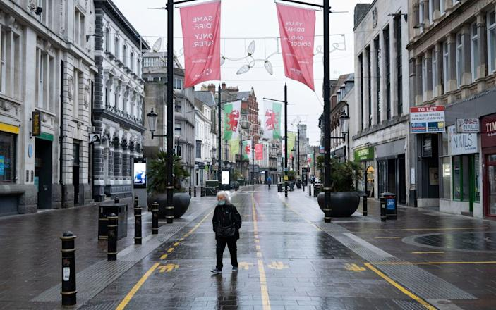 A person walks down an empty St. Mary Street on January 8, 2021 in Cardiff, Wales. Wales entered a Level 4 lockdown on December 19 - Getty Images