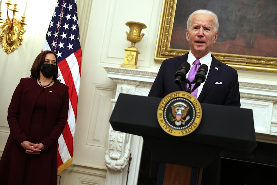 President Joe Biden, with Vice President Kamala Harris, speaks at the State Dining Room of the White House on Thursday about his administration's COVID-19 response. (Photo: Alex Wong via Getty Images)
