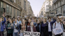 "This image released by Hulu shows activist Greta Thunberg, center, in a scene from the documentary ""I Am Greta."" The film premieres Friday on Hulu. (Hulu via AP)"