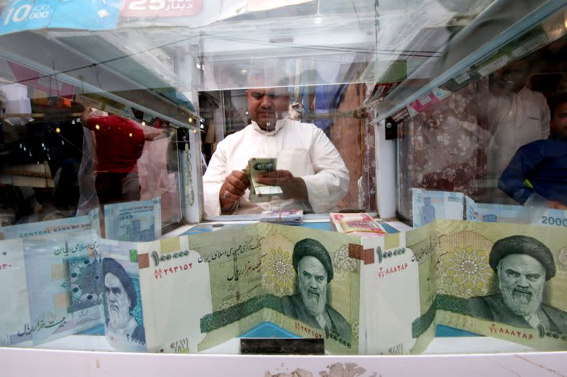 Iran rial slides to new low as coronavirus, sanctions weigh