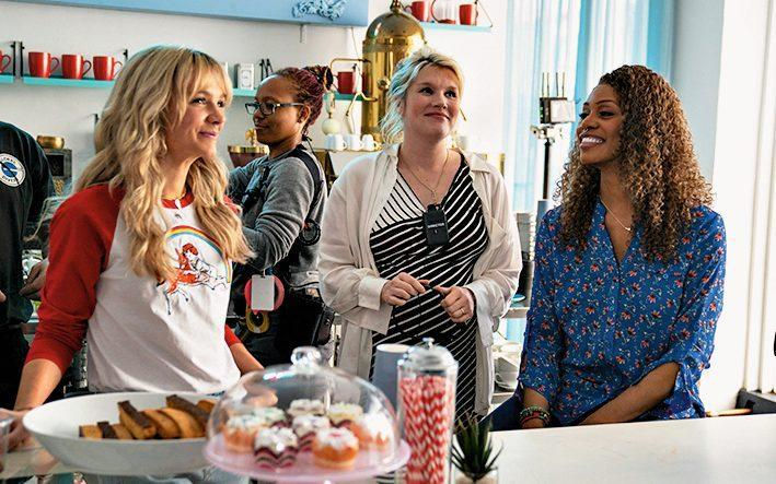 """Carey Mulligan, left, Emerald Fennell and Laverne Cox on the set of """"Promising Young Woman."""" Mulligan wears a Coco Fennell x Ceal Warnants baseball shirt. - Merie Weismiller Wallace/Focus Features"""
