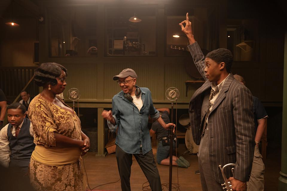 Ma Rainey's Black Bottom (2020): (L to R) Viola Davis as Ma Rainey, Director George C. Wolfe, and Chadwick Boseman as Levee. (Cr. David Lee / Netflix)
