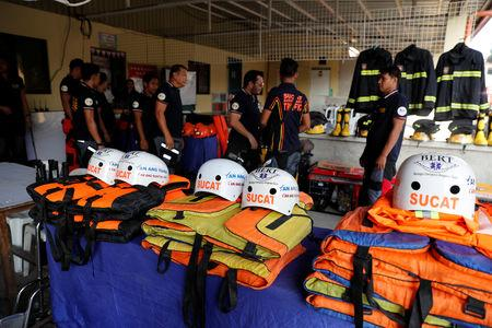 Rescuers ready their gear before Super Typhoon Mangkhut hits the main island of Luzon, in Muntinlupa, Metro Manila, in Philippines, September 13, 2018. REUTERS/Erik De Castro