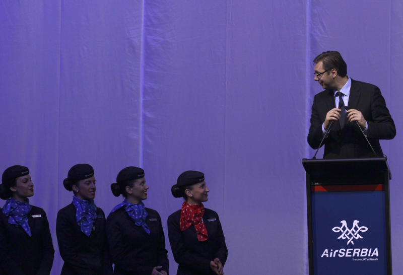 "Serbia's deputy prime minister Aleksandar Vucic, right, speaks during the inauguration ceremony of the first Airbus A319-100 aircraft in Air Serbia livery at Belgrade's Nikola Tesla Airport, Serbia, Friday, Oct. 25, 2013. Officials say that Air Serbia, Balkan country's new national carrier partly owned by Etihad Airways, formally starts flying this weekend, spelling the end for the old loss-making JAT Airways. Air Serbia's chief manager Dane Kondic said Friday that the company's inaugural flight will take place on Saturday to Abu Dhabi, United Arab Emirates. He says that ""it is an important flight that will mark a crossroads."" Kondic and Serbia's deputy prime minister Aleksandar Vucic unveiled at a ceremony at Belgrade's airport an Airbus A319 plane bearing a double-headed eagle logo in Serbia's national, red, white and blue colors. Vucic says Air Serbia hopes to become the leading regional airline. (AP Photo/Darko Vojinovic)"