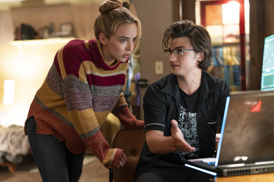 """This image released by 20th Century Studios shows Jodie Comer, left, and Joe Keery in a scene from """"Free Guy."""" (Alan Markfield/20th Century Studios via AP)"""