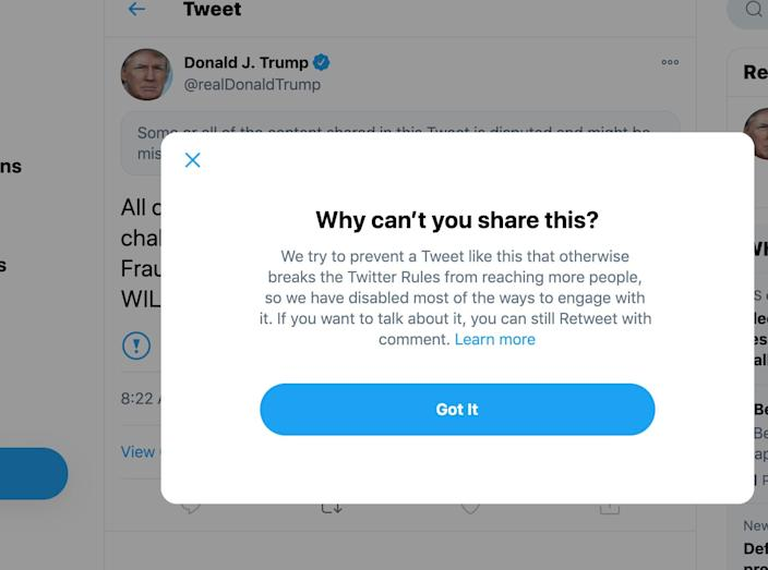 """A warning label on a tweet by president Donald Trump from Twitter that prevents re-tweeting because it """"breaks the Twitter rules."""""""