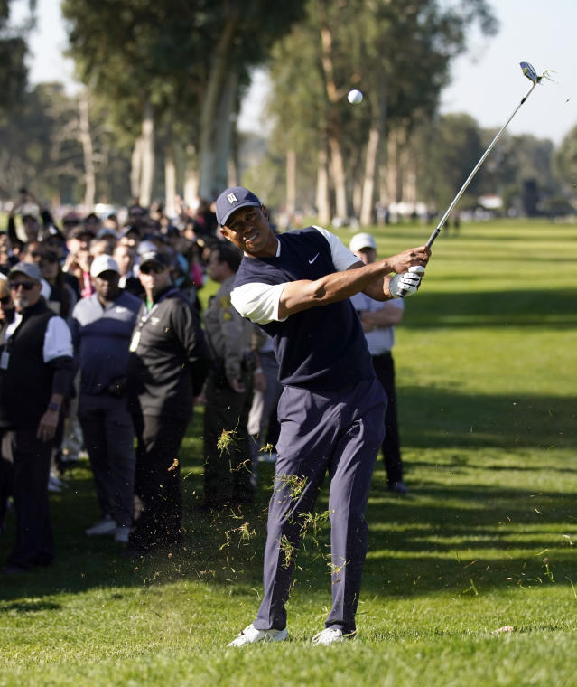 Tiger Woods hits from the rough on the 11th hole during the third round of the Genesis Invitational golf tournament at Riviera Country Club, Saturday, Feb. 15, 2020, in the Pacific Palisades area of Los Angeles. (AP Photo/Ryan Kang)