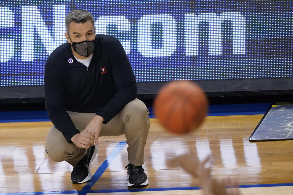 Virginia head coach Tony Bennett watches play during the first half of an NCAA college basketball game against Syracuse in the quarterfinal round of the Atlantic Coast Conference tournament in Greensboro, N.C., Thursday, March 11, 2021. (AP Photo/Gerry Broome)