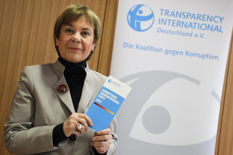Edda Mueller, chairwoman of Transparency International Germany e.V. poses for the media with the Corruption Perceptions Index 2018, prior to the presentation of the yearly report at a news conference in Berlin, Germany, Tuesday, Jan. 29, 2019. The flyer reading: 'Corruption Perceptions Index 2018'. (AP Photo/Markus Schreiber)