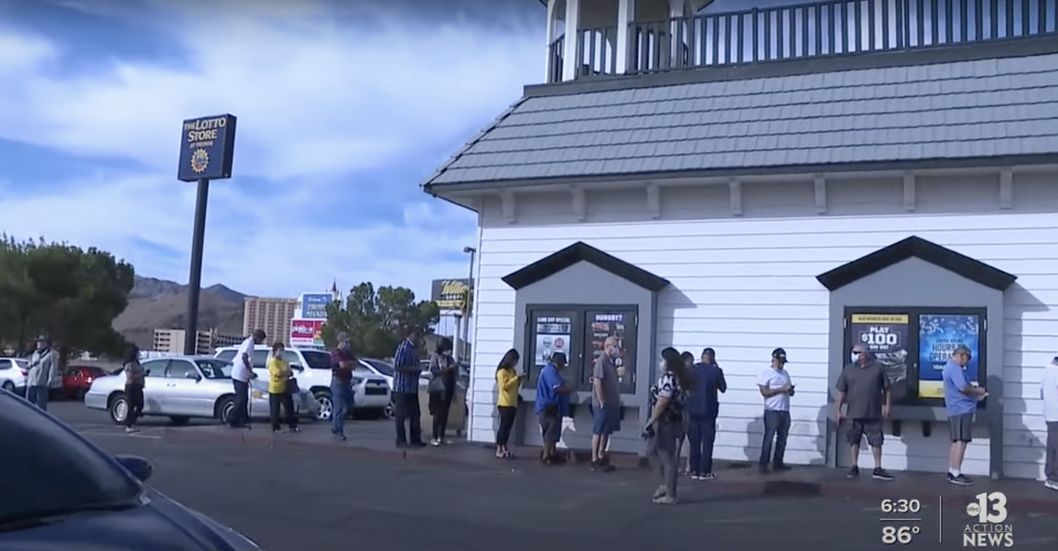 People line up to buy Powerball tickets in Vegas.
