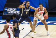 Ohio State's Zed Key (23) is pressured by Oral Roberts' Kevin Obanor (0) during the first half of a first round game in the NCAA men's college basketball tournament, Friday, March 19, 2021, at Mackey Arena in West Lafayette, Ind. (AP Photo/Robert Franklin)