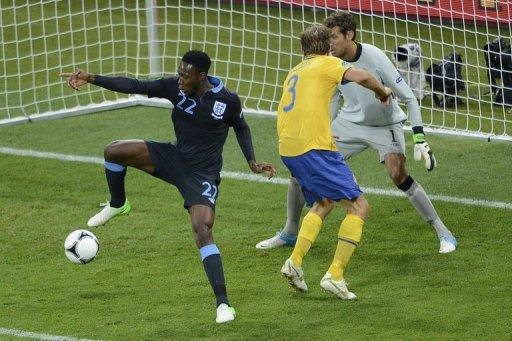 Danny Welbeck (L) flicks the ball with his heel to score past Swedish goalkeeper Andreas Isaksson