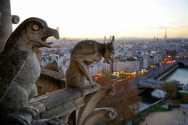 PHOTO: Gargoyles perch on the Notre Dame Cathedral overlooking the Seine in Paris, Dec. 20, 2015. (Corbis via Getty Images)