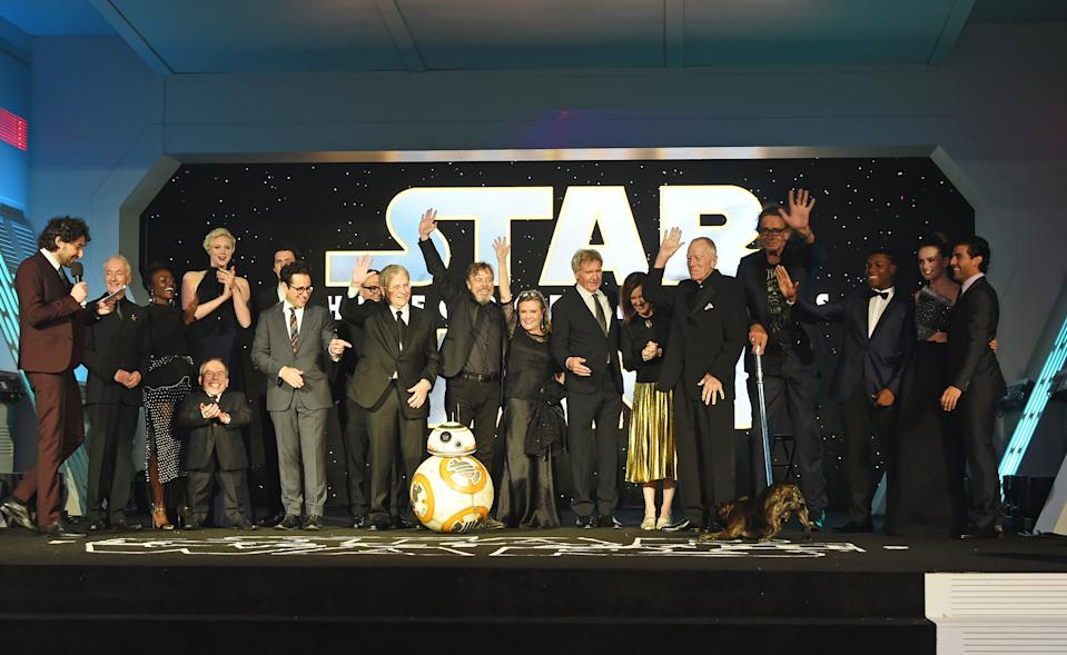 "LONDON, ENGLAND - DECEMBER 16:  Cast and crew including Anthony Daniels, Lupita Nyong'o, Warwick Davis, Gwendoline Christie, J.J. Abrams, Lawrence Kasdan, Mark Hamill, Carrie Fisher, Harrison Ford, Kathleen Kennedy, Max von Sydow, Peter Mayhew, John Boyega, Daisy Ridley and Oscar Isaac attend the European Premiere of ""Star Wars: The Force Awakens"" in Leicester Square on December 16, 2015 in London, England.  (Photo by David M. Benett/Dave Benett/WireImage)"