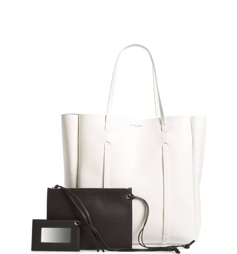 "<p>A bag you tote every day should have room for everything you need. This <a rel=""nofollow"" href=""https://www.popsugar.com/buy/Balenciaga%20Medium%20Everyday%20Calfskin%20Tote-395541?p_name=Balenciaga%20Medium%20Everyday%20Calfskin%20Tote&retailer=shop.nordstrom.com&price=1%2C250&evar1=fab%3Aus&evar9=32546198&evar98=https%3A%2F%2Fwww.popsugar.com%2Ffashion%2Fphoto-gallery%2F32546198%2Fimage%2F44265474%2FBalenciaga-Medium-Everyday-Calfskin-Tote&list1=shopping%2Cbalenciaga%2Csaks%20fifth%20avenue%2Cluxury%20fashion&prop13=desktop&pdata=1"" rel=""nofollow"">Balenciaga Medium Everyday Calfskin Tote</a> ($1,250) is that - and then some.</p>"