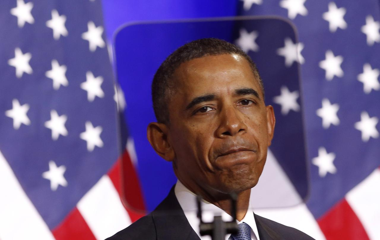 U.S. President Barack Obama is seen through a teleprompter as he speaks about the National Security Agency from the Justice Department in Washington January 17, 2014. Obama announced a ban on U.S. eavesdropping on the leaders of close friends and allies on Friday, and rein in the vast collection of Americans' phone data in a series of reforms triggered by Edward Snowden's revelations. In a major speech, Obama took steps to reassure Americans and foreigners alike that the United States will take into account privacy concerns that arose after former U.S. spy contractor Snowden's damaging disclosures about the large monitoring activities of the National Security Agency (NSA). REUTERS/Kevin Lamarque (UNITED STATES - Tags: POLITICS)
