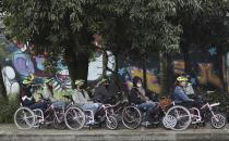 Tourists in electric wheelchairs ride at a park in Medellin, Colombia, Wednesday, Nov. 18, 2020. These weekly wheelchair tours are the latest tourist attraction in a city that is slowly shedding its reputation for drug violence and has become one of Colombia's most-visited destinations. (AP Photo/Fernando Vergara)