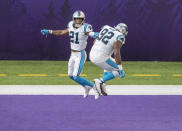 Carolina Panthers' Jeremy Chinn (21) celebrates after returning a fumble by Minnesota Vikings' Dalvin Cook for a touchdown in the third quarter of an NFL football game in Minneapolis, Sunday, Nov. 29, 2020. (Carlos Gonzalez/Star Tribune via AP)