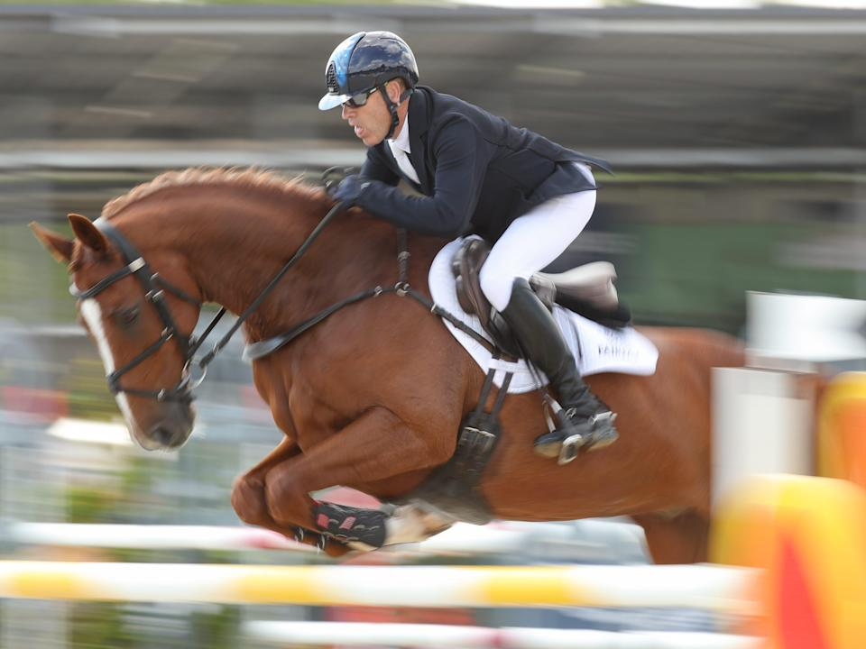 rider andrew hoy competing at the german equestrian championship in 2021