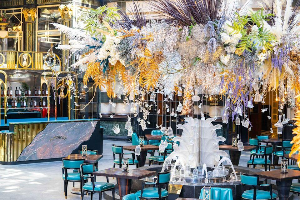 """<p>Once the hottest place to be dropped off by a cab, The Savoy's iconic turning circle has been transformed into a whisky and oyster lover's dream - <a href=""""https://www.thesavoylondon.com/restaurant/solas/"""" rel=""""nofollow noopener"""" target=""""_blank"""" data-ylk=""""slk:Solas"""" class=""""link rapid-noclick-resp"""">Solas</a>. Complete with a dramatic floral and crystal chandelier comprised of seemingly floating vintage decanters and golden oyster shells, Solas gives you all the old school art deco glamour of The Savoy with a bevy of fresh seafood and Bowmore whisky to boot. </p><p>Snuggle up in a heritage check blanket while you sip on aged whisky (out of an oyster shell no less), warm yourself with a steaming bowl of chowder and a platter of poached lobster, and take in the sheer glamour of your surroundings.</p>"""