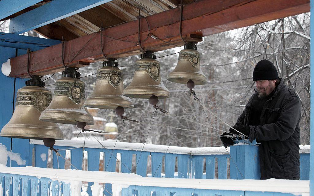RUSSIA: A monk ring bells during preparations to celebrate Orthodox Christmas at the Svyato-Uspensky Orthodox monastery in Russia's Siberian city of Krasnoyarsk, January 6, 2013. Orthodox Christians mark Christmas according to the Julian calendar on January 7.