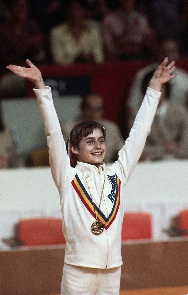 """<p>Romanian gymnast Nadia Comaneci made Olympic history at the 1976 Montreal games. After a stellar performance on the uneven bars, Comaneci earned a perfect 10.00 from the judges. This was the first time a woman had been given a <a href=""""https://olympics.com/en/featured-news/five-famous-females-revolutionized-gymnastics"""" rel=""""nofollow noopener"""" target=""""_blank"""" data-ylk=""""slk:perfect score"""" class=""""link rapid-noclick-resp"""">perfect score</a> in Olympic competition. </p>"""