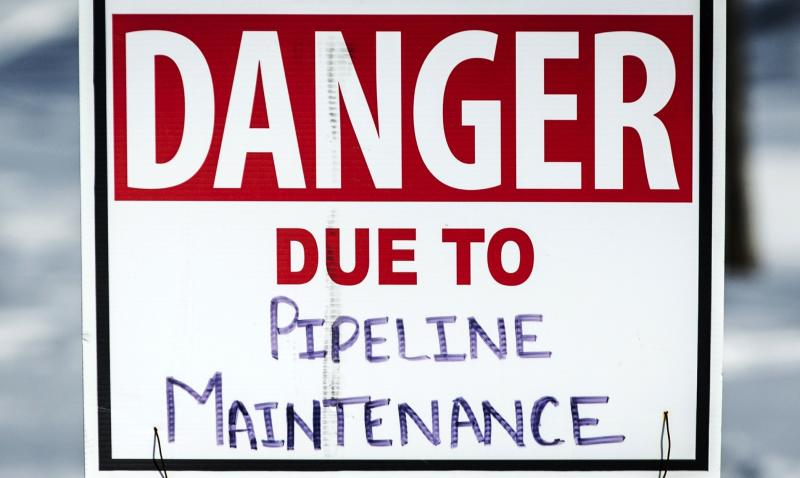 "A sign that reads ""Danger due to pipeline maintenance"" is seen on a work site for the ""Line 9"" Enbridge oil pipeline in East Don Parkland in Toronto"