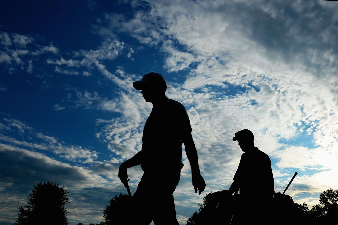 ROCHESTER, NY - AUGUST 06: (L-R) Tiger Woods of the United States walks with caddie Joe LaCava during a practice round prior to the start of the 95th PGA Championship at Oak Hill Country Club on August 6, 2013 in Rochester, New York. (Photo by Stuart Franklin/Getty Images)
