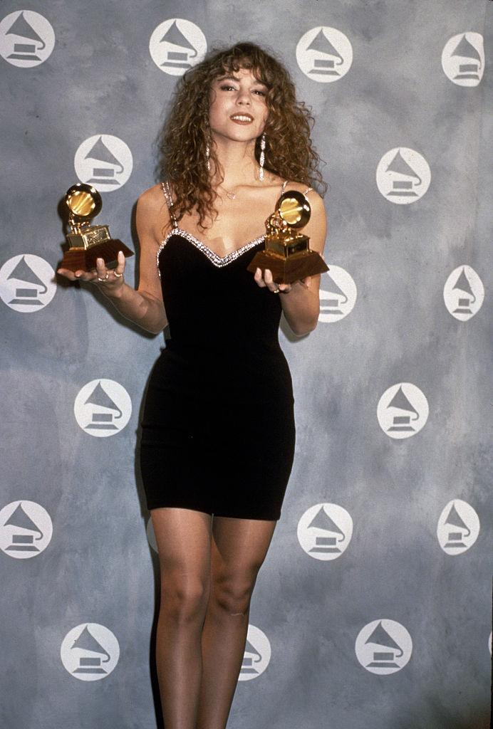 <p>This powerhouse vocalist arrived at her first-ever Grammy Awards in 1991, wearing a simple, elegant, rhinestone-edged, black, mini dress, and went home with two awards for Best New Artist and Best Female Pop Vocal Performance. (Image via Getty Images)</p>