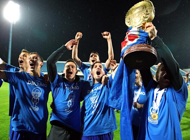 Soccer Football - Croatian Cup Final - GNK Dinamo Zagreb vs HNK Hajduk Split - HNK Cibalia Stadium, Vinkovci, Croatia - May 23, 2018. GNK Dinamo Zagreb's players celebrate with the trophy after winning the Cup. REUTERS/Antonio Bronic