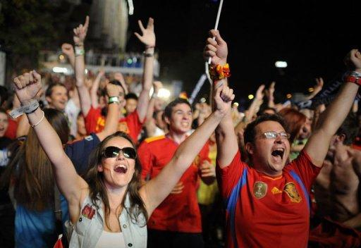 Supporters of the Spanish national football team celebrate in Madrid
