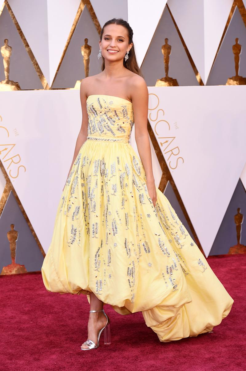 It takes quite a dress to convince us that the colour of a custard pudding is one we should consider wearing, but this Louis Vuitton gown does just that.