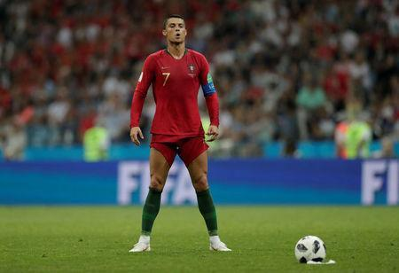 Soccer Football - World Cup - Group B - Portugal vs Spain - Fisht Stadium, Sochi, Russia - June 15, 2018 Portugal's Cristiano Ronaldo lines up before scoring their third goal from a free kick REUTERS/Ueslei Marcelino