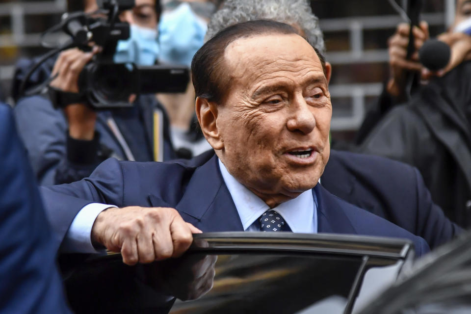 Forza Italia leader Silvio Berlusconi leaves a polling station in Milan, Italy, Sunday, Oct. 3, 2021. Millions of people in Italy started voting Sunday for new mayors, including in Rome and Milan, in an election widely seen as a test of political alliances before nationwide balloting just over a year away. (Claudio Furlan/LaPresse via AP)