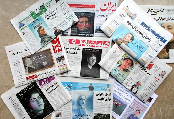 A picture taken in the capital Tehran on July 16, 2017 shows the front pages of Iranian newspapers bearing portraits of mathematician Maryam Mirzakhani, who died of cancer a day earlier (AFP Photo/ATTA KENARE)
