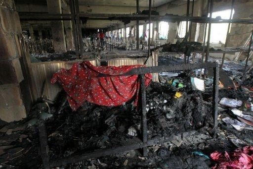 Burnt debris on the floor of the nine-storey Tazreen Fashion plant in Savar outside Dhaka on November 26, 2012. Bangladesh police fired rubber bullets to disperse thousands of workers who protested for a third day Wednesday over the nation's worst factory blaze which prompted the arrest of three plant managers