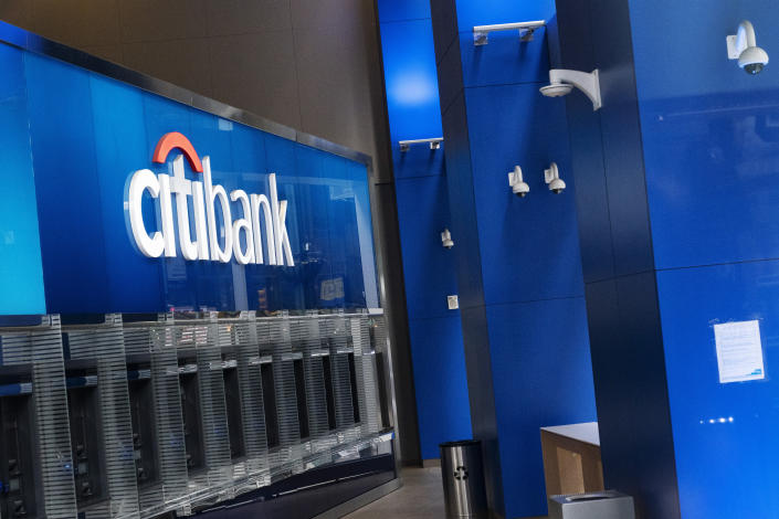 A Citibank office is open, Wednesday, Jan. 13, 2021 in New York. The nation's largest banks are expected to report big profits for the first quarter, Tuesday, April 13, amid renewed confidence that pandemic-battered consumers and businesses can repay their debts and start borrowing again (AP Photo/Mark Lennihan)