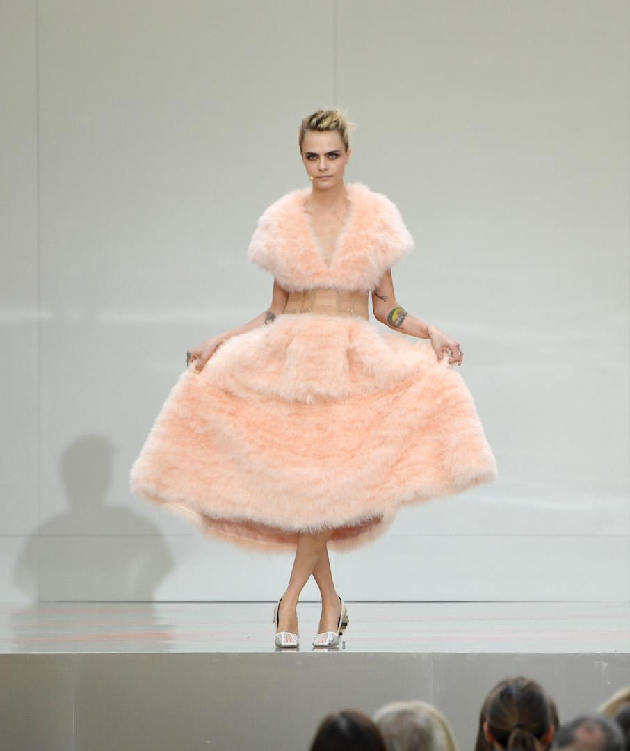 In sartorial homage to the late Karl Lagerfeld, Cara Delevingne took to the stage in a powder pink Chanel frock. <em>[Photo: Getty]</em>